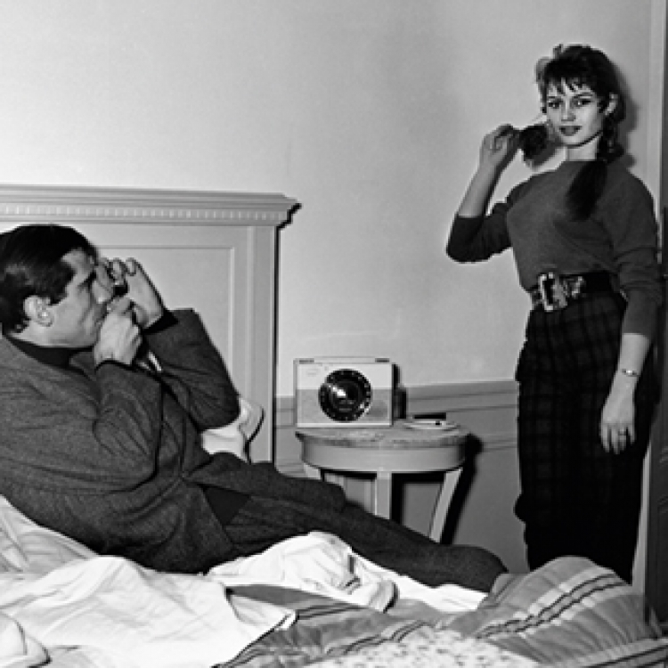 Brigitte Bardot being photographed by her husband Roger Vadim in their room at the Hotel Negresco, Nice 1955 Photo © edwardquinn.com