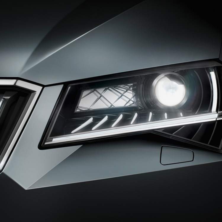 © Driven by Design - VALUES. VISIONS. ŠKODA. published by teNeues, www.teneues.com. ŠKODA SUPERB front lights, Photo © ŠKODA Auto, a.s.