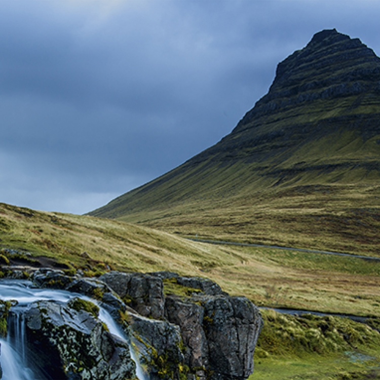 Nature as a work of art: The view of the cone-shaped Kirkjufell mountain (1,519 ft) from the nearby waterfalls is a truly fascinating sight Photo © 2017 Jürgen Wettke. All rights reserved.