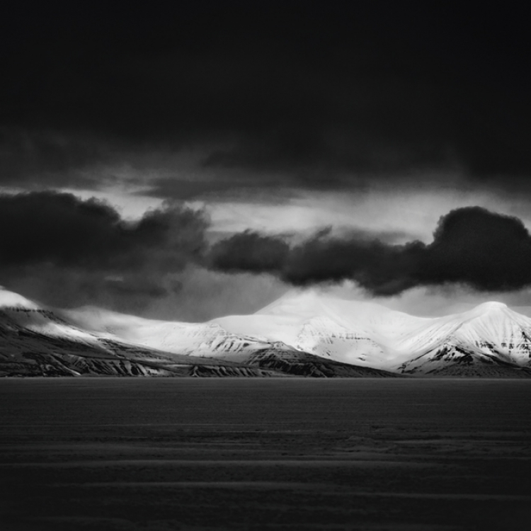 Black clouds on top of the snowy mountain,  Svalbard, 2014 Photo © Laurent Baheux