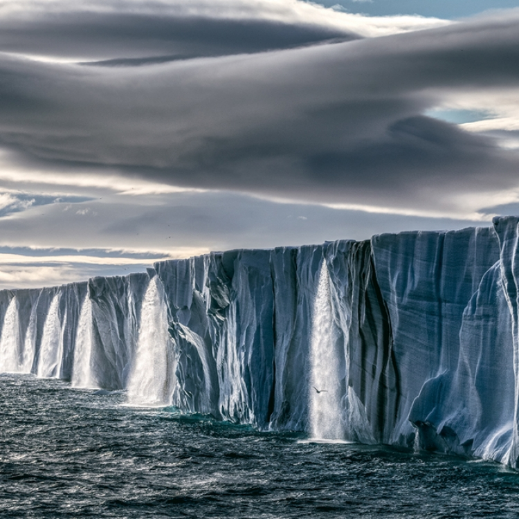 © Born to Ice by Paul Nicklen, to be published by teNeues in July 2018, www.teneues.com, Ice Waterfall, Svalbard, Norway, Photo © 2018 Paul Nicklen. All rights reserved. www.sealegacy.org
